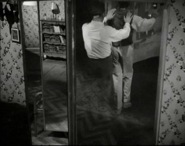 1949_Cocteau_Orphee-through-mirror_c